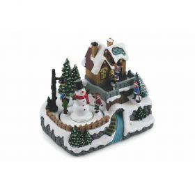 Villaggio natalizio con musica e luci